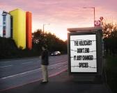 Message - Holocaust billboard man at bus stop